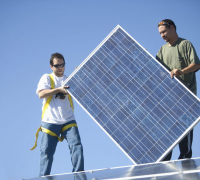 engineers holding solar panel