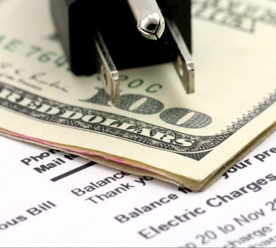 power cord and us dollar, concept of expensive energy bill